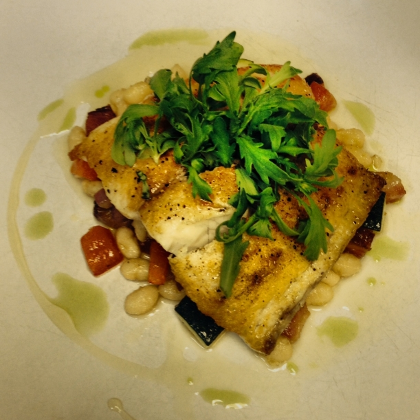 Seared Barramundi Over Navy Bean and Lardon Casoulet with Lemon-Coriander Gastrique